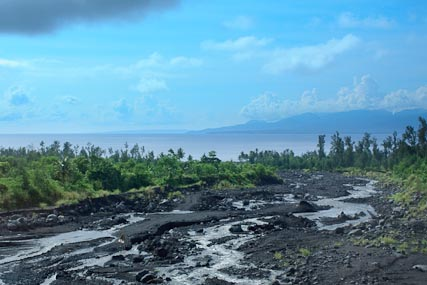 A view down off of Mt. Mayon toward the Pacific Ocean, showing the riverbed full of the remnants of the volcano's last erruption.