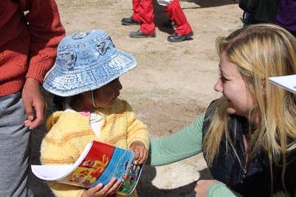Tatyana handed out some school materials to the kids.