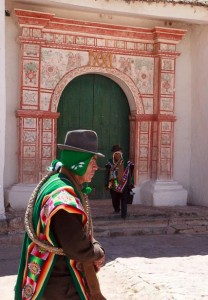 "Traditional local leaders, or ""jilakatanaka"" in Aymara, at the main door of the chapel, which is painted in renaissance style."