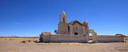Huchusuma Chapel, with Tata Sajama and the twin Payachata volcanoes, Pomerape and Parinacota